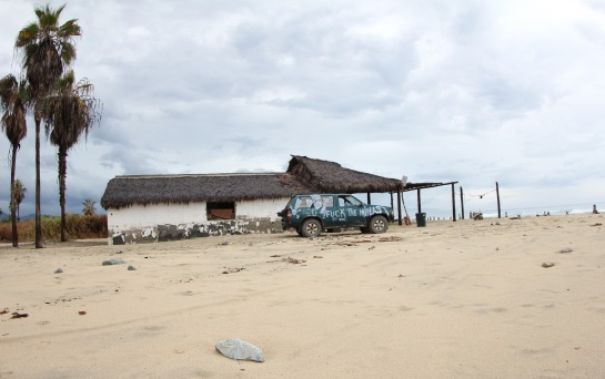 This is the before shot of an abandoned restaurant on the beach in front of the surf spot. There is a man named Ishmael who lives inside. You have to pay him 30 pesos a night if you want to camp on the beach, and he will watch your car for you. Ishmael was here when the storm hit. The place has no window or doors, and it floods when the waves get really big. It was also the center of the two earthquakes, and it is right next to a giant arroyo. He must have had one crazy night.