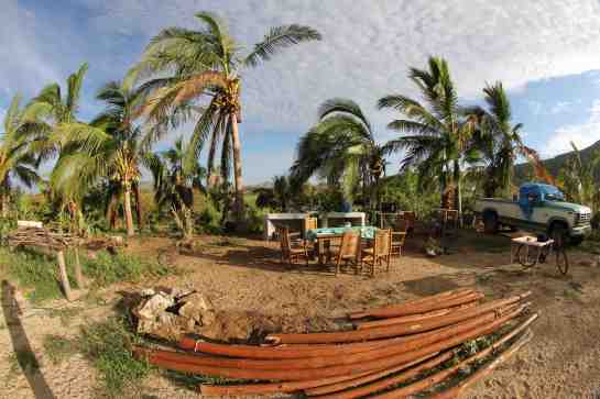 1.1.This is the farm that I have started taking care of after the hurricane. What you are looking at is the outdoor kitchen. There used to be a pallapa above the table in the center of the photo. The storm blew it down. That is what those posts in the foreground are from.