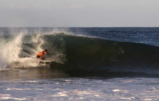 Here is another shot of Carlos stalling it up to get barreled on this left.