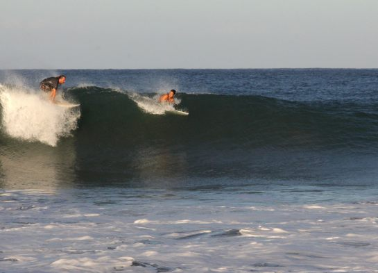 This was my first wave that morning. It was a big left coming right to me. I called this dude out of the wave cause I believed he was going to drop in on me. The slight hesitation caused me to be just a little late. You can see my trying to push my board under the lip of the wave in this shot.