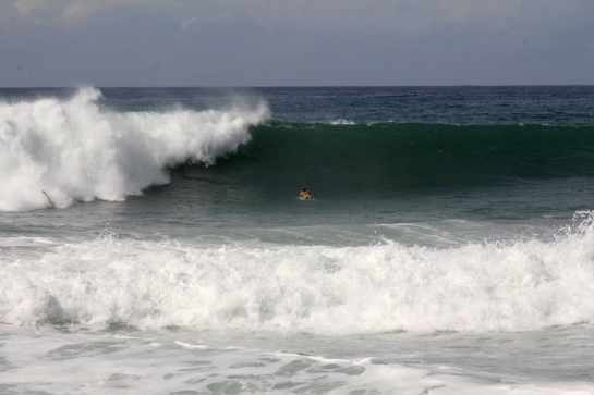 2When I got there my friends Carlos and Tacho were already out, and it was big. They were the first ones out that morning. This spot reminds me of the north shore of Oahu, only with no one there. Here is Carlos paddling alone out into the lineup.